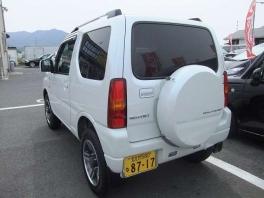 スズキ ジムニー  660 ワイルドウインド 4WD 純正ナビ 地デジ パール 2枚目